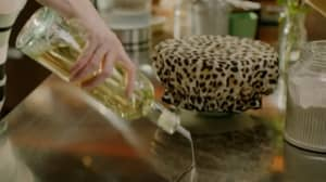 People Are Losing Their Minds That Nigella Lawson Uses A Leopard Print Shower Cap To Prove Her Dough