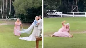 Maid Of Honour Stacks It While Trying To Get The Perfect Wedding Shot