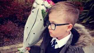 Little Boy Waits At School Gates With Flowers And Chocolates To Win Back Ex-Girlfriend