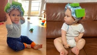 Mum Sticks Sponges On Baby's Shower Cap To Teach Her How To Walk