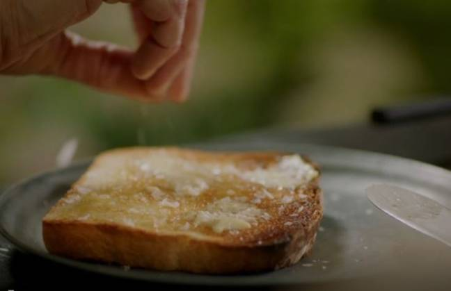 The telly cook then butters the toast for a second time using unsalted butter - and adds a sprinkling of sea salt flakes (Credit: BBC2)