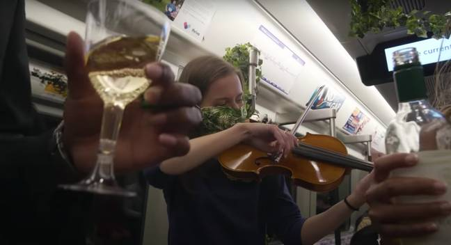 There was wine, flower garlands, speeches and violin players (Credit: YouTube / Elvin Mensah)