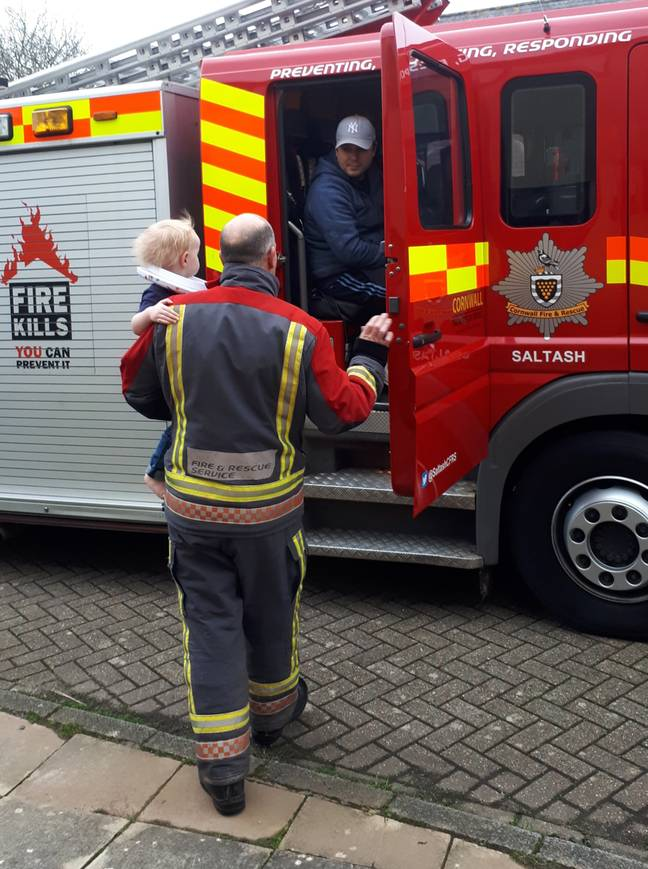 Mum Sarah was bemused to see an entire fire truck with a team of firemen arrive to rescue Flynn (Credit: Caters)