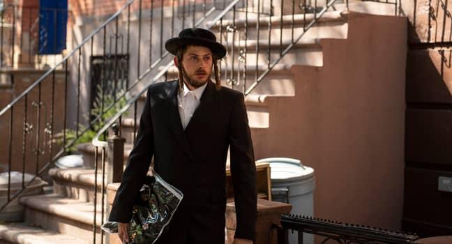 Esy's husband Yanky Shapiro (Amit Rahav) leaves New York to find his wife (Credit: Netflix)