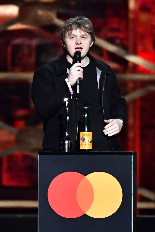 The singer took to the stage clutching a bottle of Buckfast (Credit: PA)