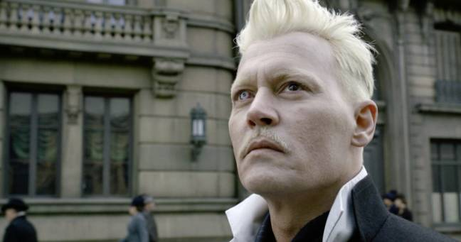 Depp previously starred as Grindelwald in two movies (Credit: Warner Bros)