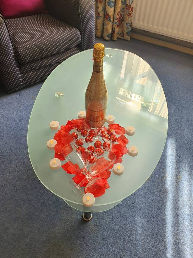 There was a bottle of champagne waiting for Hannah at her surprise proposal (Credit: SWNS)