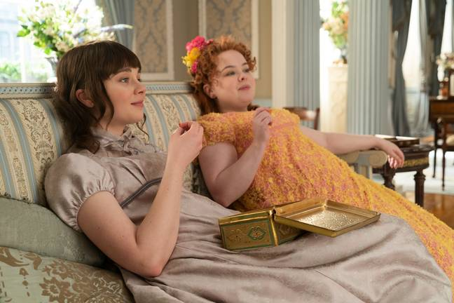 Claudia Jessie as Eloise Bridgerton and Nicola Coughlan as Penelope Featherington in Bridgerton (Credit: Netflix)