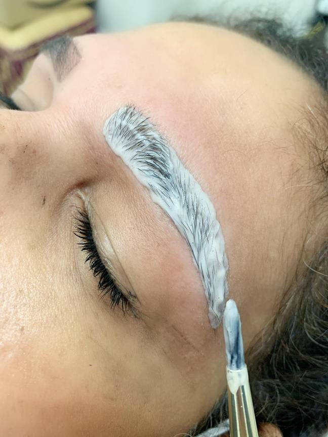 Use the applicator to coat your brows with tint, working outwards to the tail end of your brow (Credit: Brows By Suman)