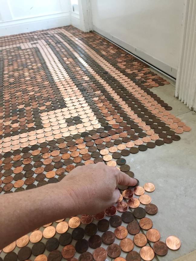 Kelly used 7,500 coins to complete the floor (Credit: Caters)