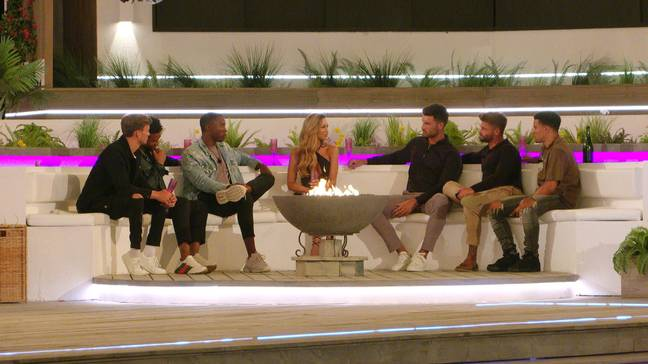 AJ having a chat with the boys around the firepit (Credit: ITV)