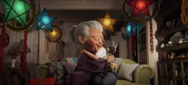Lola is given a fixed up Mickey toy by her granddaughter for Christmas (Credit: Disney)