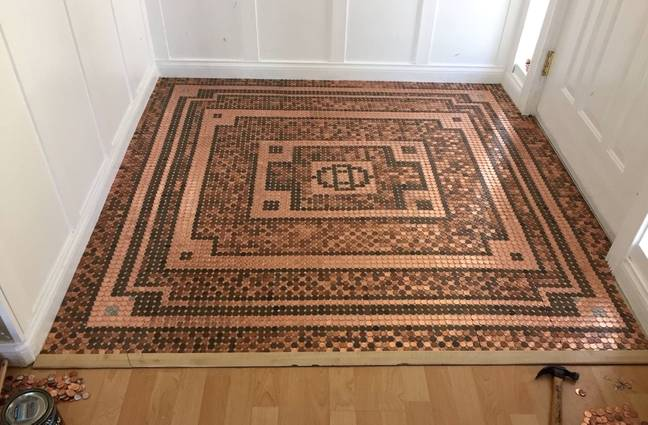 One woman made an incredible floor from just coins (Credit: Caters)