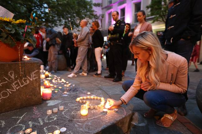 Manchester resident's gathered to pay tribute to the victims of the Manchester Arena Bombing (Credit: PA)