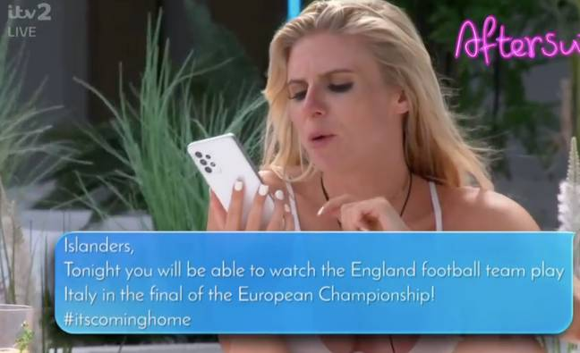 Chloe reads a text to the group (Credit: ITV)