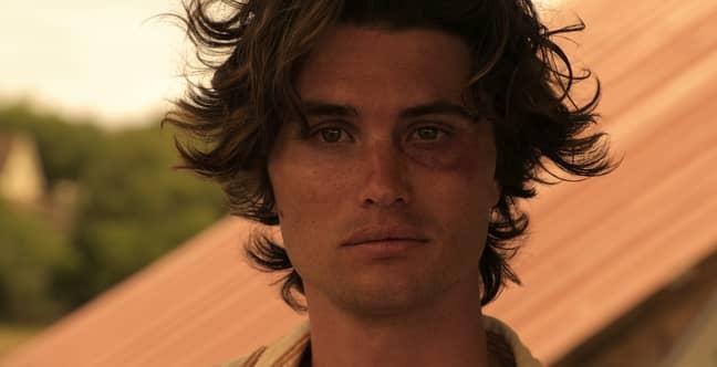 Chase Stokes stars as John B (Credit: Netflix)