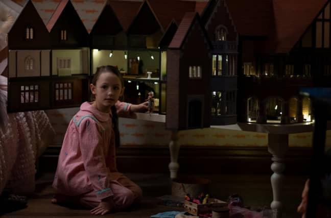 That dolls house is creepy AF (Credit: Netflix)