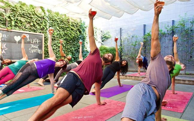Drunk Yoga classes offer a 'brief happy hour' followed by a 45-minute vinyasa sequence with a bevvy in-hand (Credit: Eli Walker / Drunk Yoga)
