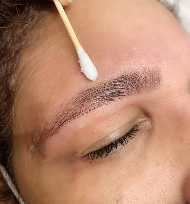 Apply a thin layer of vaseline above and below your brows to guard against staining (Credit: Brows By Suman)