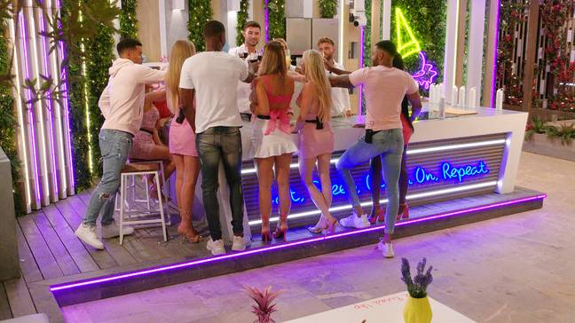 Cheers! Love Island couples toast in episode 23 (Credit: ITV)