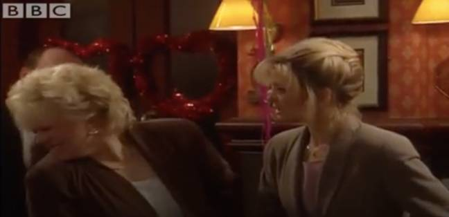 Kathy slaps Sharon, who does her best to explain (Credit: BBC)