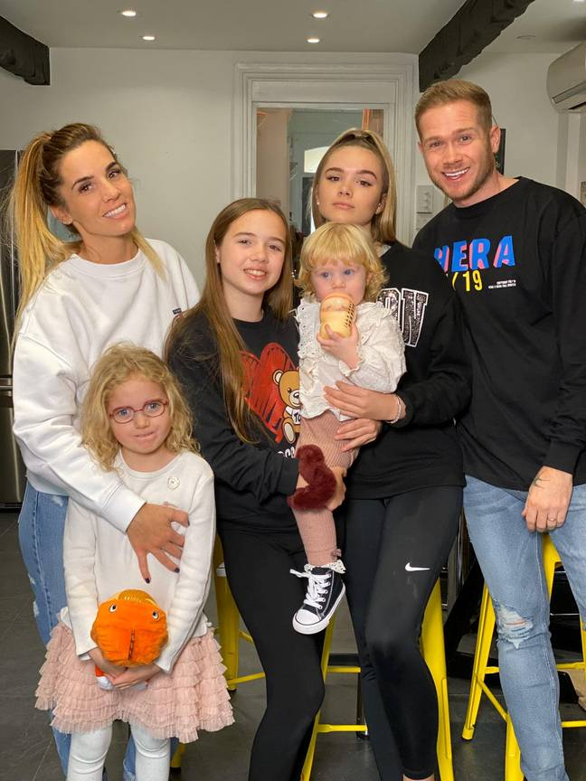 Joel with his wife Sarah and their four daughters (Credit: SWNS)