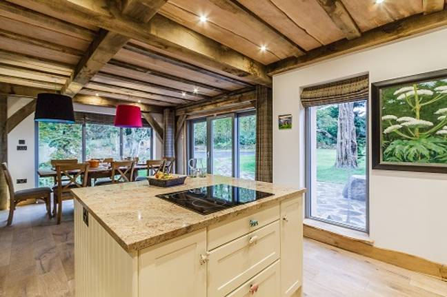 There's a huge kitchen and dining room with panoramic views (Credit: Old Knock Castle)