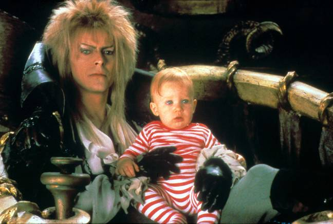 The Goblin King - played by the late David Bowie - steals baby Toby (Credit: TriStar Pictures)