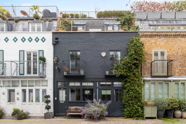 The house features a smoky grey exterior (Credit: Knight Frank)