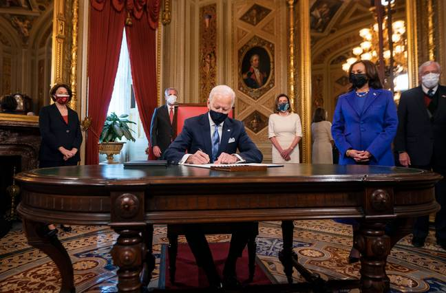 Biden got to work as he arrived in the Oval Office (Credit: PA)