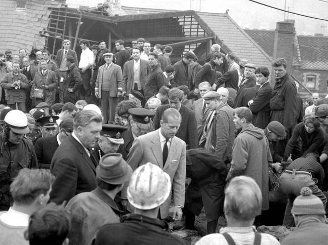 The Duke of Edinburgh visiting the disaster the following day. (Credit: PA)