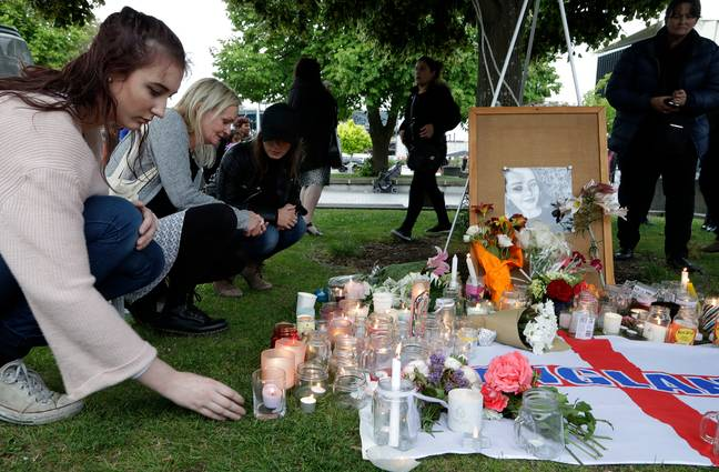 People light candles during a vigil for Grace Millane in Cathedral Square in Christchurch, New Zealand, shortly after her body was discovered. (Credit: PA)