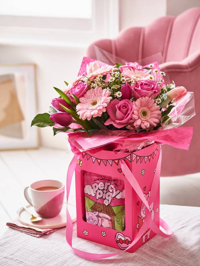 The Valentine's Percy Pig Gift Bag features a beautiful bouquet of pink flowers and Percy sweets (Credit: M&S)