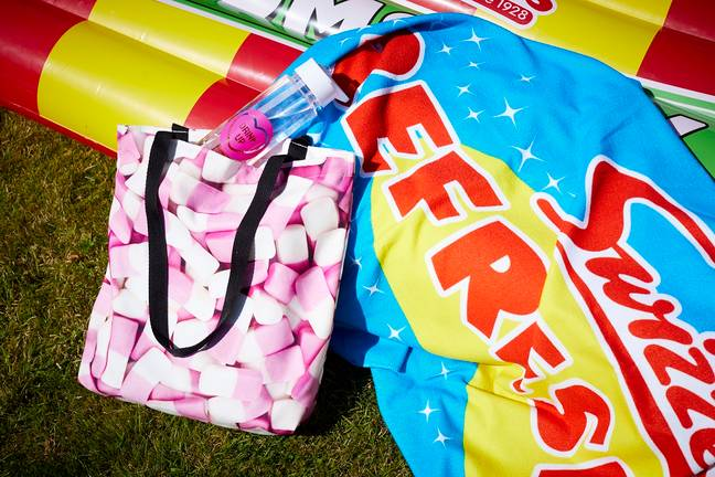 Swizzels are selling a Love Hearts water bottle, £9.99, and Squashies Beach Bag, £14.99. Credit: Swizzels