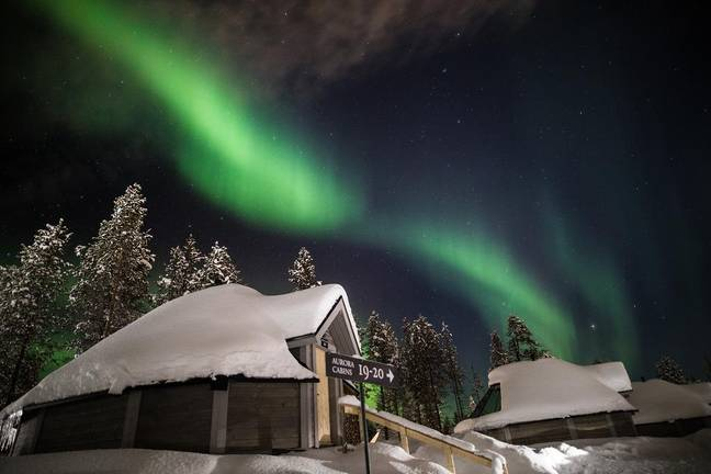 The resort is set in the snowy, forested landscape of Saariselkä, Northern Finland (Credit: Northern Lights Village)