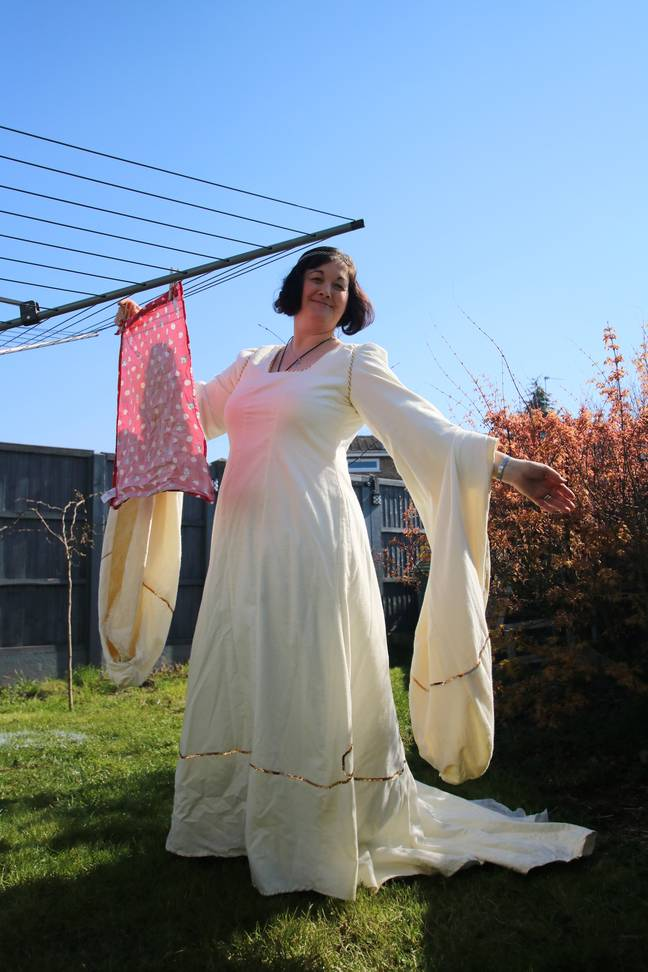 One woman wore a Medieval-style gown to hang out her laundry (Credit: SWNS)