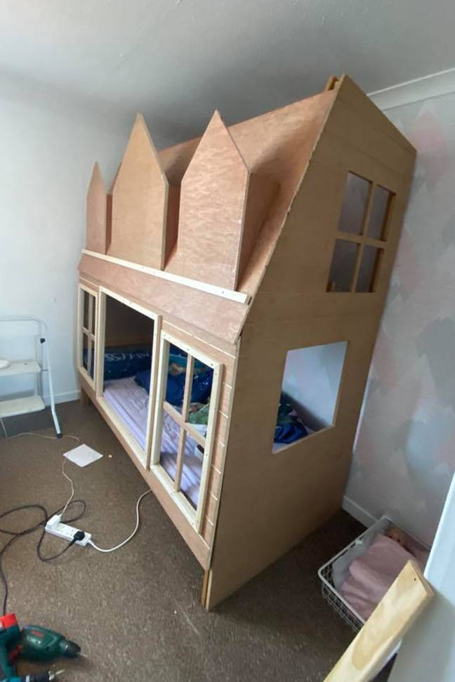 The couple used spare wood and a bed frame they already owned to create the doll's house design (Credit: Caters)