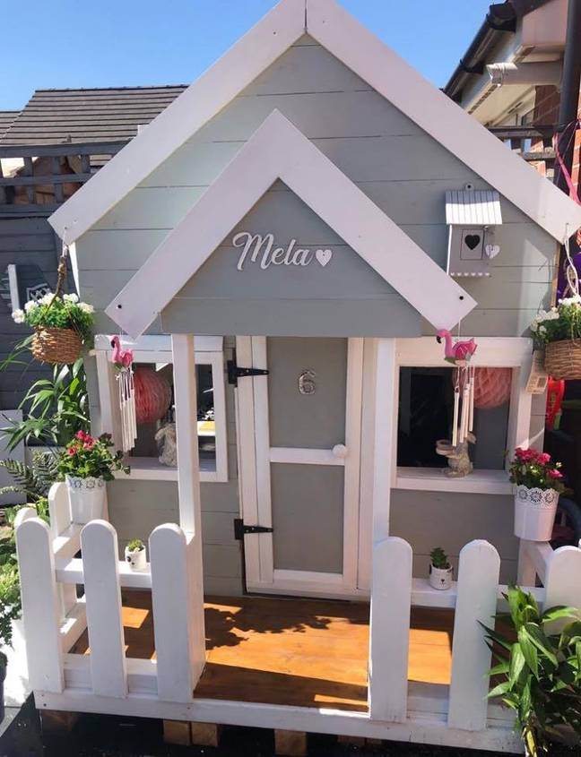 The beautiful house features a white picket fence and hanging baskets around the porch (Credit: Katie Corry/Extreme Couponing and Bargains UK Group)
