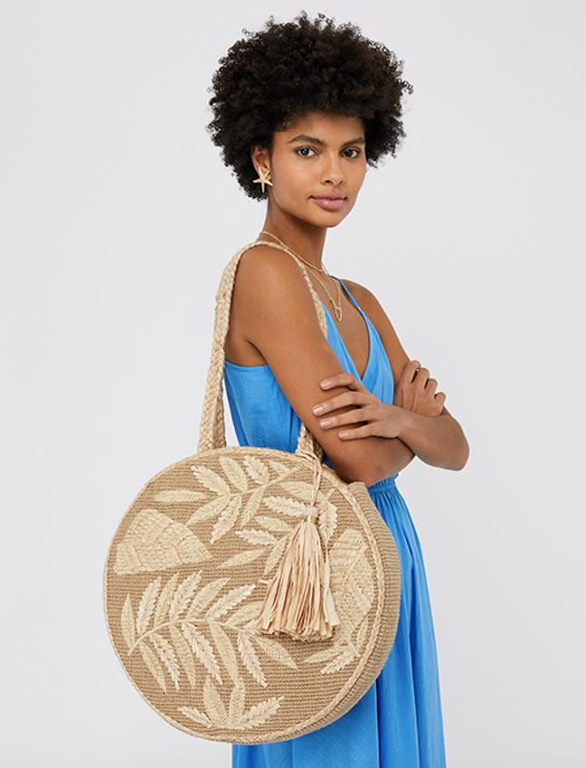 I still shop there now, in fact i'm currently eyeing up this dreamy raffia bag (Credit: Accessorize)