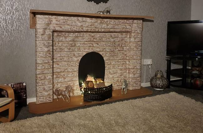 The fireplace in near the end of construction. (Credit: Caters)