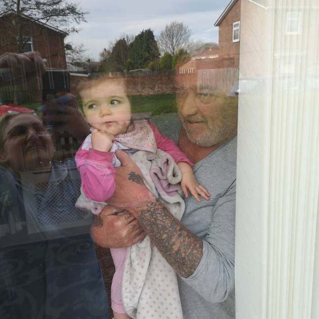 Jay can only see her kids through her window (Credit: Caters)
