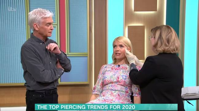 Holly lay down to get her ears repierced (Credit: ITV)