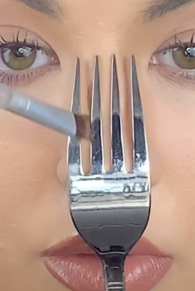 Brush the dark contour along the thin line of the fork prom (Credit: @elliemakeupartist/ TikTok)