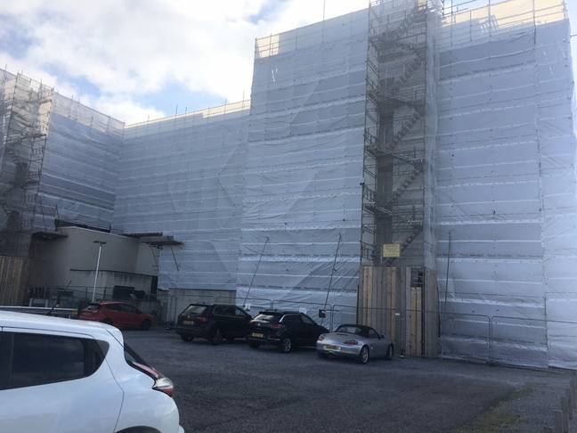 Roger took pictures of the outside of the hotel covered in white sheeting (Credit: Kennedy News)