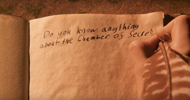 Harry Potter chats to Tom Riddle through the diary, not knowing it's his enemy Voldemort. Credit: Warner Bros.