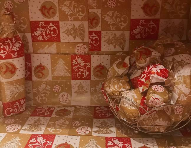 They spent two hours wrapping the contents of their kitchen in Christmas paper. (Credit: Caters)