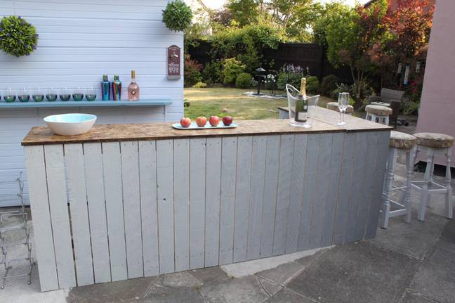 Craig created an incredible outdoor bar himself, using pallets and reused wood (Credit: Craig Phillips)