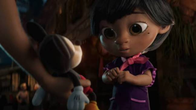In the cute advert, we see Lola being given a Mickey Mouse toy by her father (Credit: Disney)
