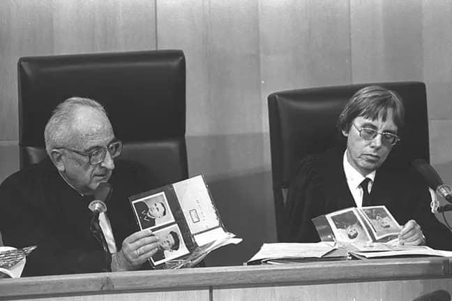 Supreme court justice Dov Levin and district court judge Dalia Dorner looking at a photo album during the trial of John Demjanjuk in Jerusalem (Credit: Yaakov Saar/Wikimedia)