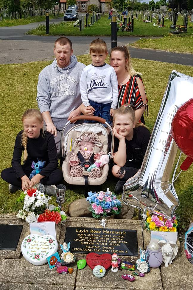 The family had been visiting the grave of their daughter Layla, who was sadly stillborn last year (Credit: Caters)